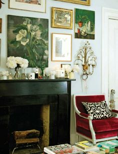 vintage eclectic, painting collection and fireplace