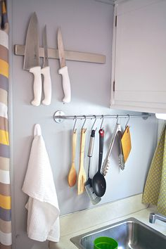 When this family embraced small-space living and moved into a 150-foot camper, they got smart about organizing. A towel bar repurposed as a place to hang spoons and spatulas turns a blank wall into a useful storage spot. See more at The Noshery » - GoodHousekeeping.com
