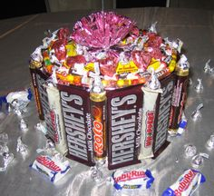 "Want a great centerpiece? Design a candy and chocolate ""cake"". Use larger candy bars around the side of a stack of round Styrofoam disks. Add a slew of candy on the top. You can even add balloons on the top."