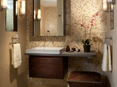 12 Bathrooms: Ideas You'll Love: Designer Joseph Pubillones enveloped this small space in a serene palette of tiles and added mirrors for light and the illusion of space. (Photo by Daniel Newcomb) From DIYnetwork.com