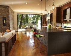 Great modern twist in this kitchen with beautiful darker stained Maple hardwood floors.