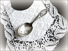 antique French baby bib and a baby spoon engraved 'Joy' ... photo ⓒmonica roberts