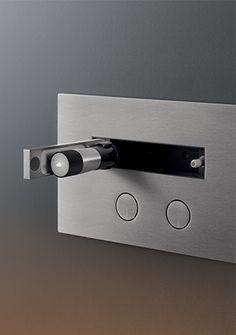 Ceadesign HYDROPLATE 05 755-830 euro +iva innovativo programma di placche per cassetta WC in acciaio AISI 316/L, dotate di pulsanti a filo ed idroscopino a scomparsa, che rivoluziona la concezione dello scopino per la pulizia del wc, poiché si collega direttamente all'impianto della cassetta WC. Garantisce il risparmio idrico grazie al doppio flusso della cassetta (Geberit)