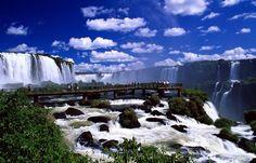 Sightsee at the breathtaking Iguassu Falls in Foz Do Iguacu, Brazil.  http://www.vacationsmadeeasy.com/