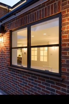 This contemporary home extension featured steel look aluminium windows and French doors. Aluminium has many advantages over steel such as being more cost effective and requiring less maintenance, however the steel look aestehtic is extremely popular. With the Sieger Legacy range, customers can have all the advantages of aluminium with the elegant design of steel framed glazing. Casement Windows, Windows And Doors, Aluminium Windows, Our Legacy, House Extensions, Steel Frame, French Doors, Timeless Design, House Ideas