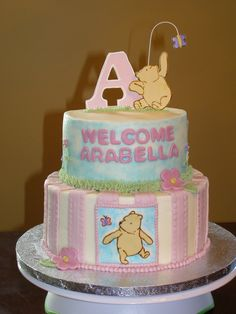 Classic Pooh Baby Shower - My husband's best friend of 25 years and his wife recently had their first baby so I did the shower cake.  The nursery is Classic Winnie the Pooh so I put a girly twist on it!  Cakes are iced in buttercream with MMF decorations.  Decorations on top are gumpaste.  I got to use my airbrush for the first time!  Pooh bears were cut out and hand-painted with gel colors.