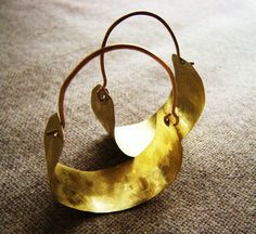 La Sevillana -- Wide brushed matte gold brass hammered earrings Hoop Hand Forged Bohemian summer Fashion. $28.00, via Etsy.