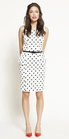 1/28/13: Pretty cute! Polka dots, black & white, peplum-- this dress is the perfect marriage of trends. Add a red shoe and the look's complete!