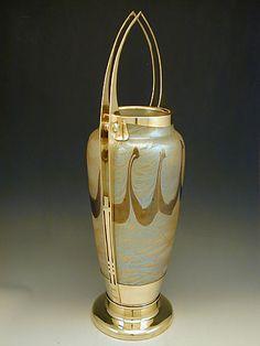 ManufacturerLoetz for E. Bakalowits DesignerHubert Gessner & Koloman Moser Iridescent glass vase with polished brass secession Art Nouveau mount. Austria Datec.1905