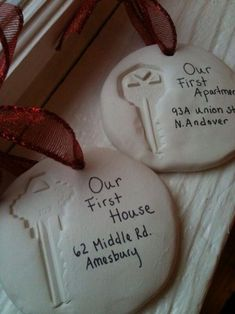 Press keys into modeling clay, writing significance and address on them. For display or future Christmas ornaments