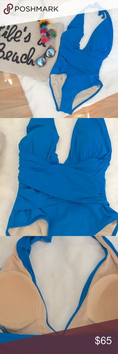 La Blanca | Halter One Piece Blue halter one piece from La Blanca. Ties at your neck and has a plunging neckline. Structured padded cups, low back, ruched at the middle. Moderate coverage. New! La Blanca Swim One Pieces