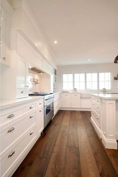 Image result for white kitchens with dark wood floors
