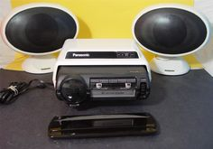 This is a Panasonic Model CQ-880 EU 12 volt FM Car Stereo in excellent condition with a Home cabinet, model CJ-18HEU and a pair of speakers, with adaptable bases that can be moved to rear of speaker-- model CJ-18SEU.
