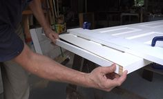 Builder Rick Arnold demonstrates how to make a clean cut and how to add blocking to fill the hole you've just made in the bottom of the hollow door.