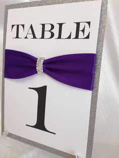 Purple and Silver Rhinestone + Glitter Wedding Table Number- Rhinestone Brooch, Any Color Ribbon- Display Stand Included! on Etsy, $8.75