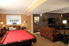 Great family room in basement with pool table.