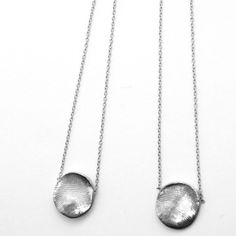 Silver Scapular Necklace Kit - (by Jook & Nona via Fab.com) - I LOVE this! How amazingly sweet would it be to have your husband's print on one side and the wife's on the other. Or if you have kids you could do their prints. So sweet!