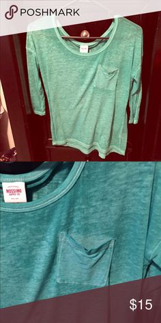 Soft, quarter sleeve t-shirt Beautiful turquoise color tee. Quarter sleeve with pocket on the front. Very soft. Will accept offers! Tops Tees - Long Sleeve