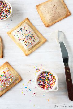 Homemade rhubarb apple pop tarts | homemade crust filled with apple rhubarb compote and decorated with a simple icing and sprinkles so that they look just like the classic breakfast treat