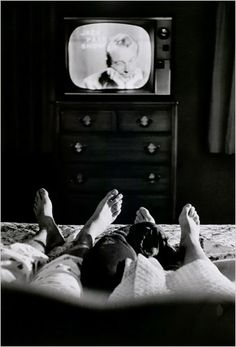 Jack Paar watched himself on television in a show taped earlier in the day with his wife at home in Bronxville, N.Y., 1959.  Photo: Cornell Capa/Magnum Photos, courtesy of the International Center of Photography