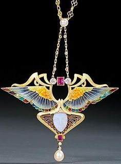 Art Nouveau gold, enamel, diamond, ruby, pearl and opal pendant necklace, by Philippe Wolfers, Belgium, circa 1902. The pendant depicting the goddess Nike.