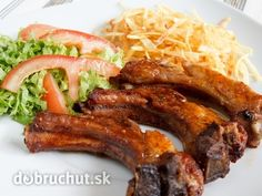 Photo about Pork ribs french fries and fresh salad. Image of grill, ribs, tomato - 19850893 Russian Recipes, Pork Ribs, Sausage, Steak, Bacon, Favorite Recipes, Beef, Breakfast, Potatoes