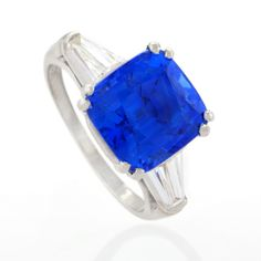 The blue in this is AMAZING!!  Ceylon Sapphire and Diamond Platinum Ring.
