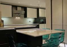 Terra Oak vaneer & white glass doors and Gutman Arte hood - See more at: http://www.bravermankitchens.co.uk/kitchens/modern-kitchens/#sthash.MkEBtNXI.dpuf #ModernDesign #ModernKitchen #KitchenDesign #Gutman
