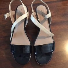 Wedges black and beige Black and beige wedges size 10. Never worn bought brand new. Extreme weight loss and they don't fit. Alfani Shoes Wedges
