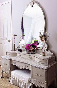 Elegant Multi-Tiered Vanity with Oversized Mirror