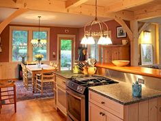 Timber frame home kitchen and dining area