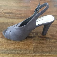 Gray suede peep-toe, sling-back heels! Soft gray Naturalizer heels. Cute peep-tie and sling-back. These shoes are so comfy!!! You can where them all day. I typically wear a 8.5 so these run a bit big. Lightly worn. Super cute with skinnies and with skirts. Let me know do you have questions:) Naturalizer Shoes Heels