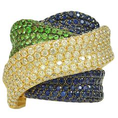 Dramatic Twisted Band of Diamonds, Sapphires and Green Garnets