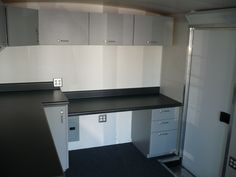 Custom laminate cabinets and chemical resistant laminate counter top in mobile testing laboratory. Orange, CA.