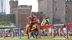 A jousting competition as part of a re-enactment at Cardiff Castle, Cardiff, South Wales