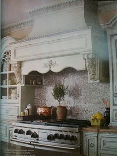 A must for every french kitchen: an awesome oven hood. From FRENCH COUNTRY COTTAGE: MY DREAM KITCHEN...