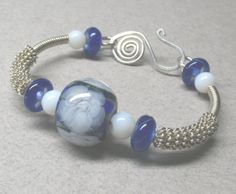 Blue Bangle Wire Wrapped Bracelet by MarigoldJewelry on Etsy, $124.00