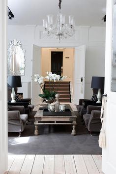 ByMaleneBirger_gray chairs; white walls; chandelier