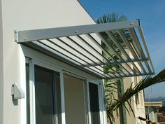 Cantilevered awnings are the modern sleek design of todays passive louvre systems. The cantilever relies on a specially designed welded bracket. The bracket is a welded 6mm angle plate which has been cut on a rake to create a more appealing look. The rear of the angle is a 10mm base plate. This is the fixing point. This size of the base plate will depend on the projection of the awning. The bigger the projection, the bigger the base plate.
