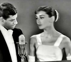 """rareaudreyhepburn: """"Audrey Hepburn presenting the Best Picture Oscar to producer Harold Hecht for Marty at the 28th Academy Awards, March 21, 1956. Jerry Lewis hosted the evening's festivities...."""