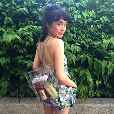 Clearly #FestDressed: Thuong in the Printed Floral Crossback Romper in Magnolia & the Clear Mini Back Pack.