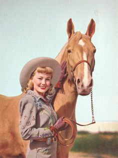 Vintage Cowgirl with cute bangs and adorable big, round curls. Circa late 1940s during the Western craze.