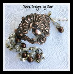 Victorian Lady Cuff Bracelet .. Rusty Black component that has been buffed back to show the copper .. Chain has pearls, crystals, and brass components .. FOR SALE $36.00