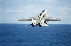 F-14 taking off with aerial banner tow target