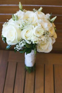 Lovely Hand Tied Wedding Bouquet Comprised Of: White Roses, White Ranunculus, White Lisianthus & Buds, White Gypsophila + Green Foliage