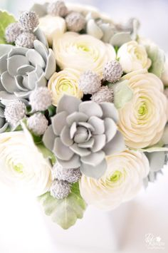 silver brunia, silver succulents, ivory ranunculus and Dusty Miller leaves