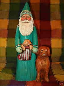 Santa with two Golden Retrievers.  Original wood carving by Oregon artist, Jani Brown.  eBay seller:  janijims-at-home