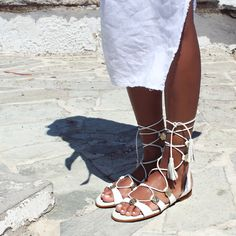 An outstanding pair you'll want to wear season after season. Get the most out of these gladiator-boho-sandals in white! ☯️ #papanikolaoushoes #komisandkomis #leathershoes #sandals #ancientgreeksandals #bohostyle #whitesandals Boho Sandals, White Sandals, Ancient Greek Sandals, Leather Shoes, Boho Fashion, Lace Up, Pairs, Seasons, Flats