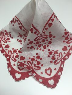 A lovely vintage valentine handkerchief for your sweetie! This white handkerchief has a red border with white hearts as well as sprays of red