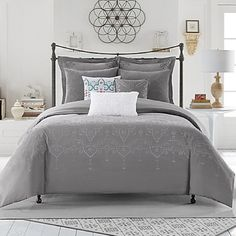 Anthropology Bed Set Grey bedding, extremely soft and comfortable with white eyelet details. Comes with bedding, pillowcase has minor mark from the wash but isn't noticeable. Perfect for dorm bedding! Purchased from Bed Bath and Beyond, the brand is anthropology Anthropologie Other